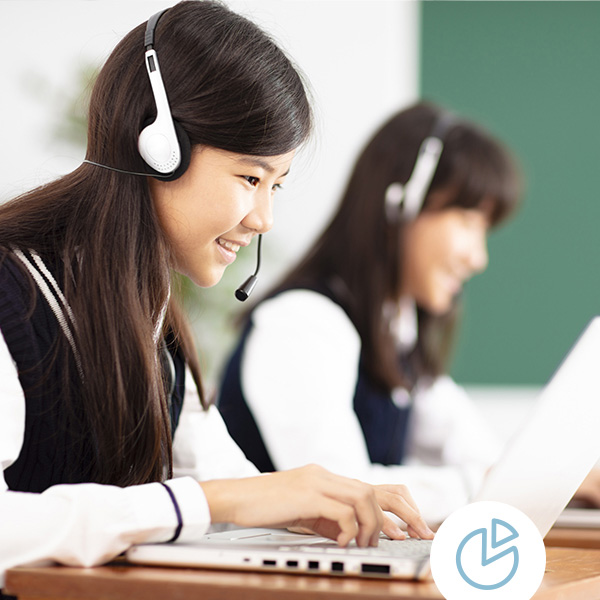 Students wear headsets while testing on laptops